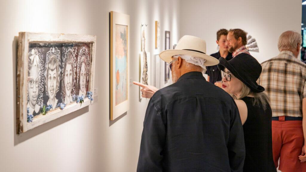 Adults at art exhibit